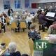"""Einen gemütlichen Nachmittag erlebten die Mitglieder von """"Senioren aktiv"""" beim traditionellen Neujahrsempfang. Im Hintergrund stehend die Vorsitzende des gemeinnützigen Verein Marion Kohlhoff."""